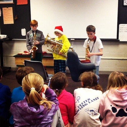 A trio of 5th graders play for their classmates