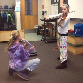 Violinist performs for her class